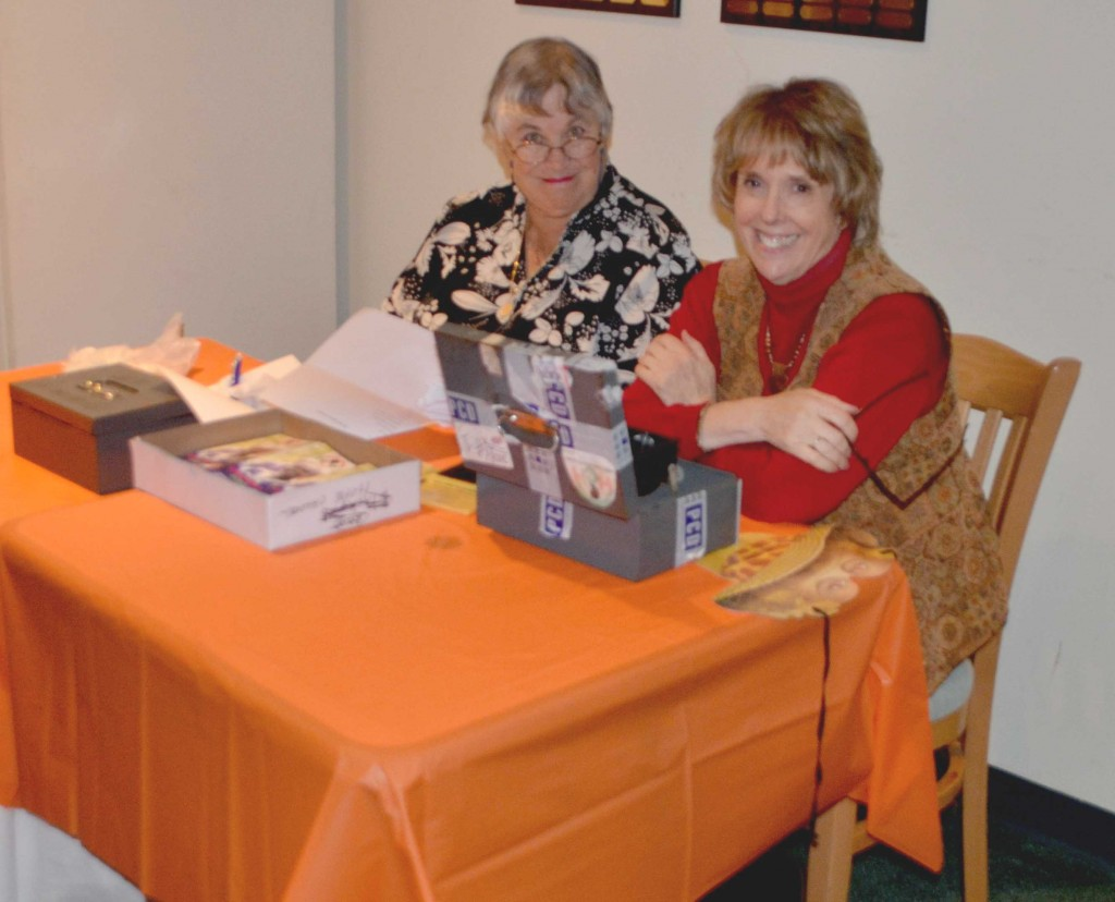 HCF board member Yvette Hohler and Pat Slavinski as they get ready to greet our guests at the Halloween Gala.