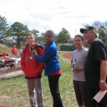 The fastest American runner, 14 year old Anthony Lynch, receives his medal from Valerie Cartright.  The quickest female, Tracy Subject, and Larry Hohler look on.